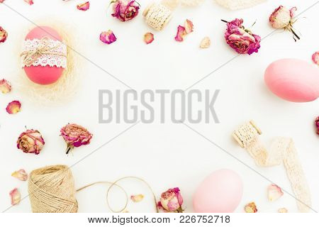 Frame Of Easter Pink Eggs With Twine, Flowers And Tapes On White Background, Top View, Fat Lay. East
