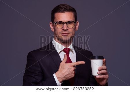 Portrait In Violet Tone - Young Male Manager In Formal Attire And Glasses With Coffee On Gray Backgr