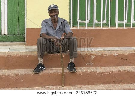 Beggar With A Cigar And A Stick Asks Begging On The Steps Of The House Of Trinidad Cuba 2018 January