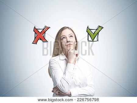 Portrait Of A Beautiful Young Businesswoman Wearing A White Shirt And A Skirt And Thinking. She Is L