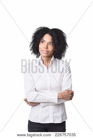 Isolated Portrait Of A Thoughtful African American Businesswoman Wearing A White Blouse And Standing