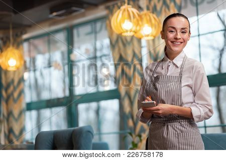 Listen Attentively. Sincere Gorgeous Beautiful Waitress Taking Order While Staring At Camera And Spe