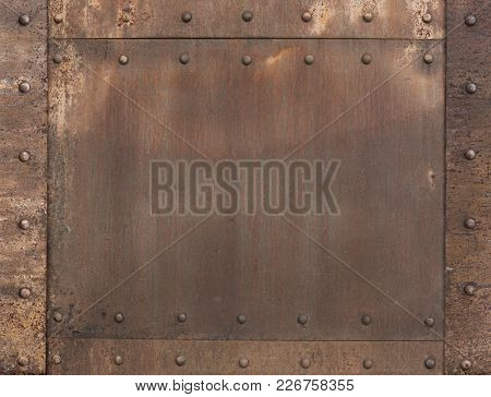 old rusty metal background with rivets