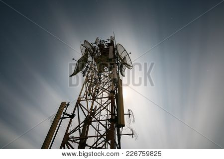 Telecommunications Antenna For Radio, Television And Telephone. Long Exposure At Night