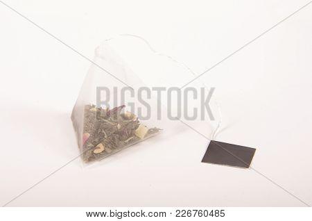 Pyramid Shape Teabag On The White Background