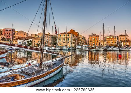 Boats In La Maddalena Harbor At Sunset, Sardinia