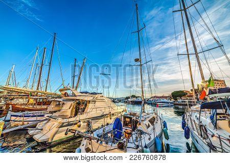 Boats In La Maddalena Harbor In Sardinia