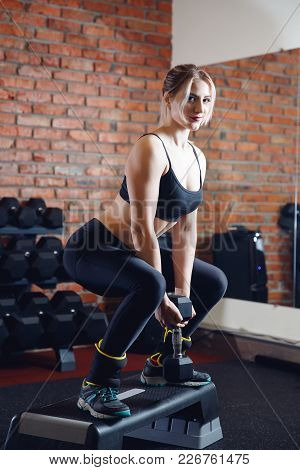 Aerobics. Close-up Of Athletic Shoes, Girl Performs Exercise Step On Podium With Weighting. Concept