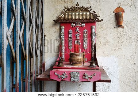 Malacca, Malaysia - February 05, 2018 : View On Small Family Altar In China Town With Inscription On