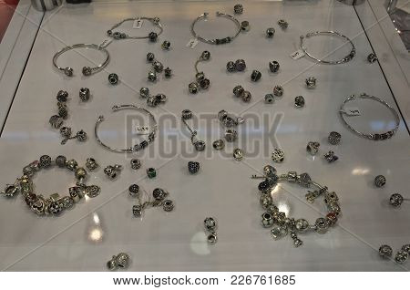 Bunch Of Cheap Jewelry Displayed On Table