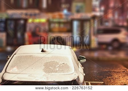 Car With The Frozen Windshield Covered With Ice And Snow In A Winter Frosty Night.
