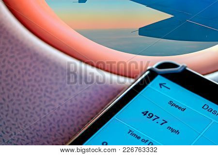 Indication Of The Speed Flight On The Gps Navigator. On The Background With Porthole With The Bright