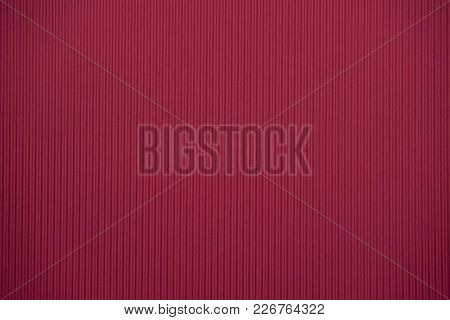 Crimson Colored Corrugated Cardboard Texture Useful As A Background