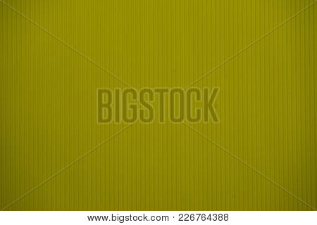 Dark Yellow Colored Corrugated Cardboard Texture Useful As A Background