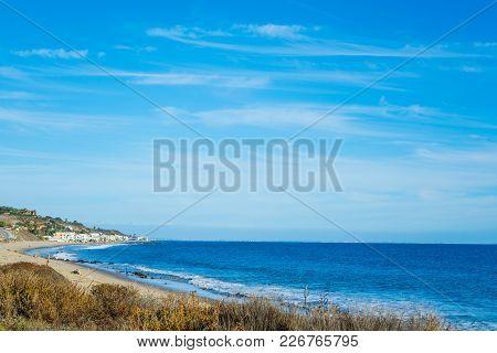 Blue Sea In Malibu Shoreline In California