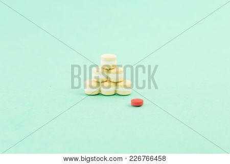 Pile Of Pills And A Red One As Out Of Pattern Concept