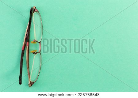 Goggles Or Spectacles On Green Table Board