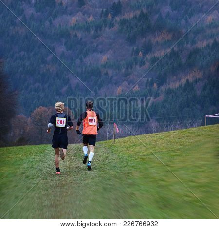 Athlete On Cross Country Running Championship In Nature