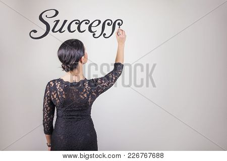 Young Business Coach Writing Out The Word Success In The Air