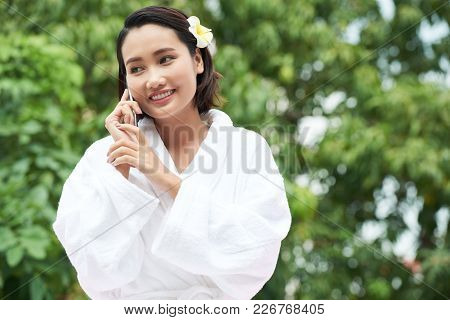 Beautiful Young Woman In Bath Robe Calling On The Phone