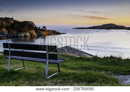 Bench With Lovely Ocean View In The Afternoon.