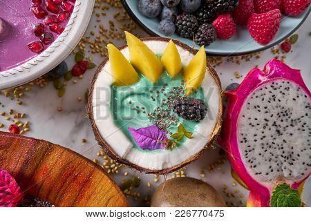 Spirulina algae bowl smoothie with mango Pitahaya dragon fruit