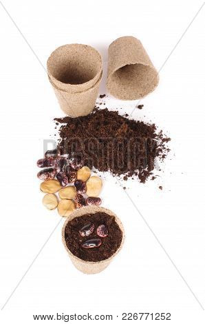 Argiculture Concept: Seads, Heap Of Soil And Peat Pots