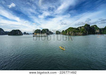Halong Bay In Vietnam, Unesco World Heritage Site, With Paddling Kayak.