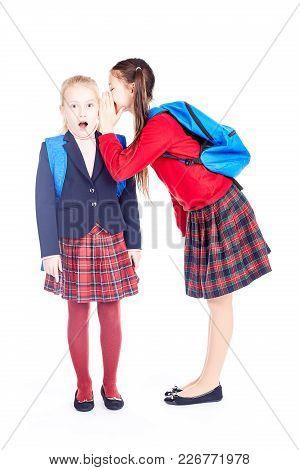 School Girlfriends In Uniform Gossiping On White Background