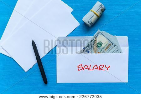 White Envelopes With Money Lie On A Black Wooden Table. Bribe In An Envelope. Salary