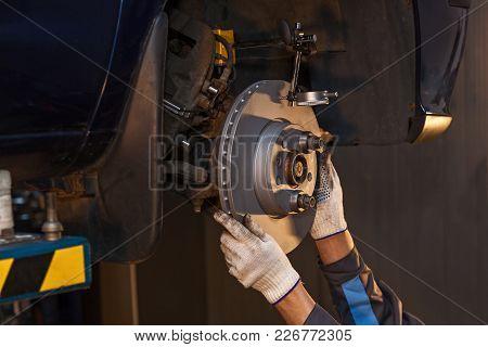 The Man Is Repairing The Disc Brake In The Car. Repair Disc Brake.