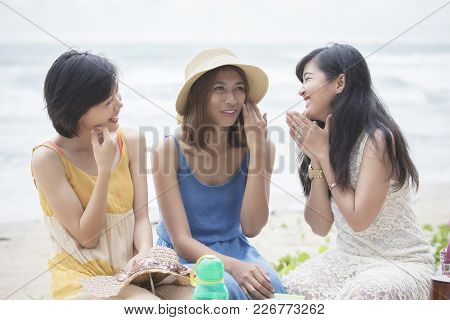 Younger Asian Woman Friend Relaxing Talking With Happiness Emotion At Vacation Sea Beach