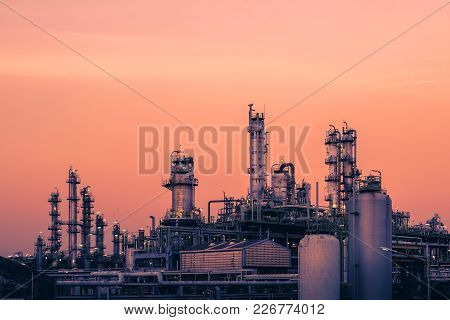 Petrochemical Plant With Sunset Sky Background, Oil And Gas Refinery Plant, Manufacturing Of Petrole