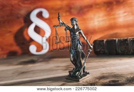 Statue Of Justice - Lady Justice Or Iustitia / Justitia The Roman Goddess Of Justice On A Wooden Tab