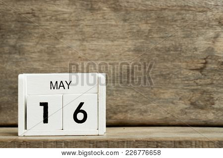 White Block Calendar Present Date 16 And Month May On Wood Background