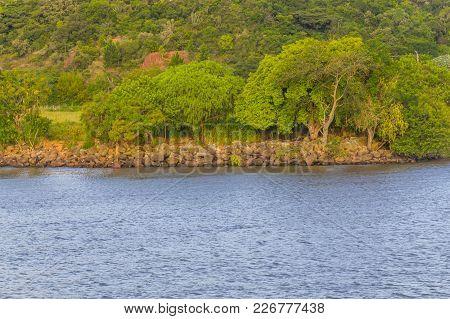Guaiba Lake With Rocks And Trees