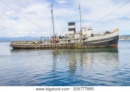 Old Boat In Beagle Channel With Mountains In Ushuaia