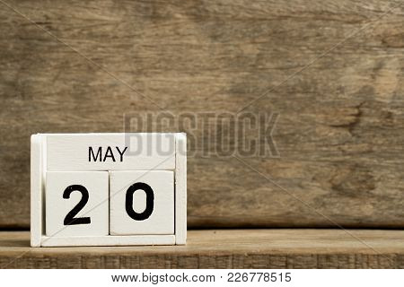 White Block Calendar Present Date 20 And Month May On Wood Background