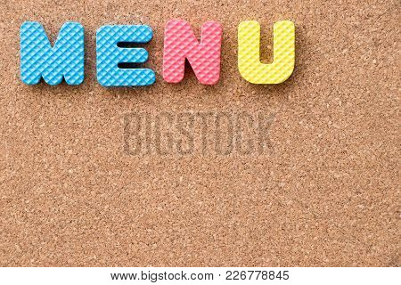 Color Toy Foam Alphabet In Word Menu On Cork Board Background