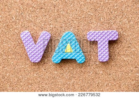 Color Toy Foam Alphabet In Word Vat (abberviation Of Value Added Tax) On Cork Board Background