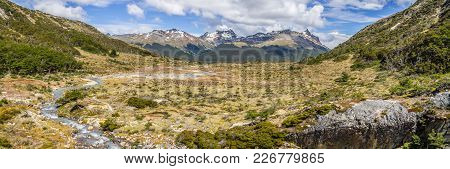Panorama Of Stream In Laguna Esmeralda Trail With  Mountains And Vegetation