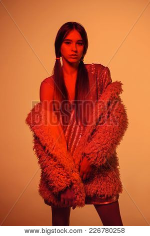 High Fashion Model Woman In Colorful Bright Lights Posing, Portrait Of Beautiful Girl With Trendy Ma