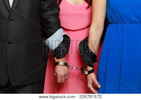 Couple Cheating Problems, Love Triangle Concept. Wife And Husband In Handcuffs, Jealous Woman Standi
