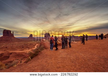 Monument Valley, Utah, Usa - December 31, 2017 : Tourists And Photographers Enjoy A Dramatic Sunrise