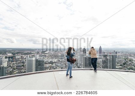 Tourist Couple Taking Photos And Enjoying The Beautiful Skyline View On A Sunny Saturday Afternoon F