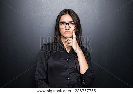 Portrait, Skeptical, Serious Senior Young Woman Looking Suspicious, Disapproval On Face Isolated Bla