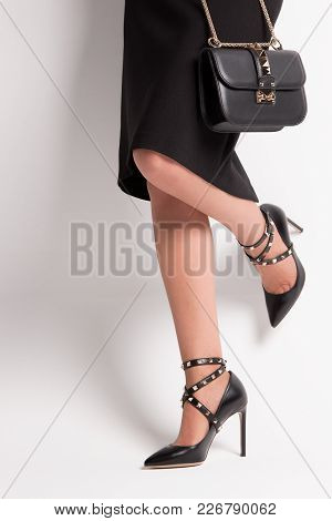 Girl In High-heeled Shoes With Spikes. Accessories With Fashion Spikes