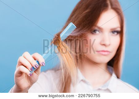 Care Coiffure Haidressing Professional Beauty Concept. Girl With Comb. Young Smiling Lady Combing Ha