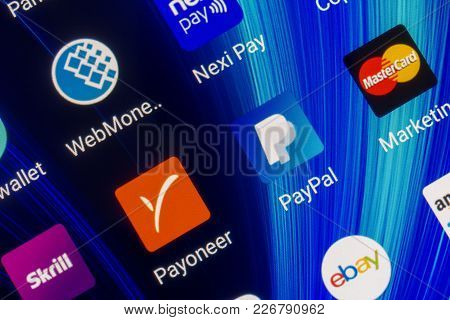 Adygea, Russia - February 12, 2018: Mobile Applications Of Electronic Payment Systems Paypal, Payone