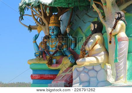 Lord Vishnu And Two Wise Men. Sculpture Of Religious Themes In Tirupati, India.